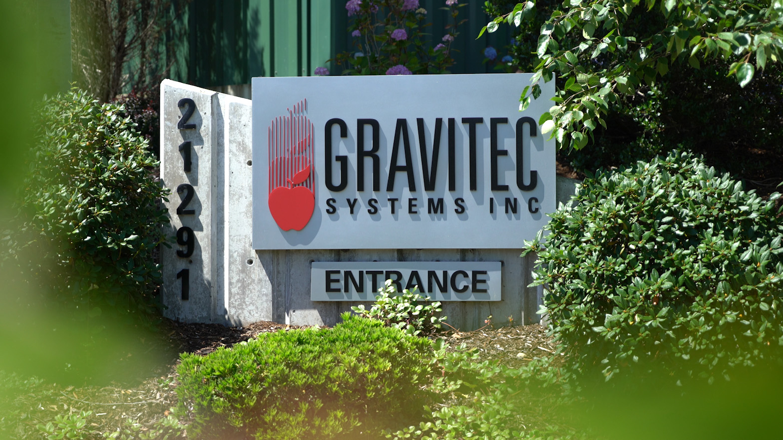 Gravitec entrance sign in front of the building.